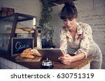 woman using tablet for online... | Shutterstock . vector #630751319