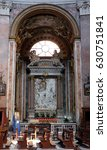 Small photo of ROME, ITALY - SEPTEMBER 02: St Francis of Paola venerating the icon altarpiece in chapel of Our Lady of Miracles, Church San Giacomo in Augusta in Rome, Italy on September 02, 2016.