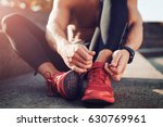 man tying jogging shoes.a... | Shutterstock . vector #630769961