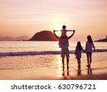 asian family standing on beach... | Shutterstock . vector #630796721