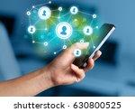 finger pointing on smartphone... | Shutterstock . vector #630800525