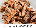 roasted pork with charcoal... | Shutterstock . vector #630824909