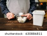 female hands holds spoon with... | Shutterstock . vector #630886811