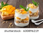 mango and pineapple parfaits in ... | Shutterstock . vector #630896219