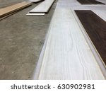 Small photo of wooden floor plank in macro picture of wood colored choices on alteration work for interior floor installation