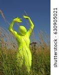 Small photo of ufo alien strange faceless creature on the field