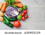 a set of fresh vegetables on a... | Shutterstock . vector #630905159