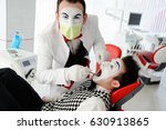 an evil dentist treats a tooth... | Shutterstock . vector #630913865