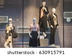 women clothing in a showcase in ...   Shutterstock . vector #630915791