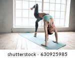 young woman doing yoga pose... | Shutterstock . vector #630925985