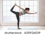young woman doing yoga pose... | Shutterstock . vector #630926039