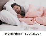 sick young man fever concept | Shutterstock . vector #630926087