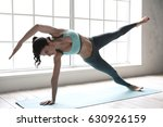 young woman doing yoga pose... | Shutterstock . vector #630926159