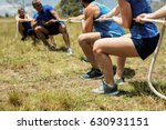people playing tug of war... | Shutterstock . vector #630931151