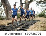 people receiving tire obstacle... | Shutterstock . vector #630936701