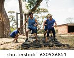people receiving tire obstacle... | Shutterstock . vector #630936851