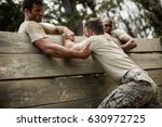 soldiers helping man to climb...