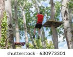 young man on zipline in... | Shutterstock . vector #630973301