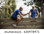 male trainer assisting woman to ... | Shutterstock . vector #630978971