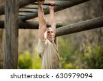 soldier climbing monkey bars in ... | Shutterstock . vector #630979094