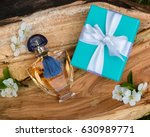 the bottle of perfume and the... | Shutterstock . vector #630989771