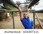 fit man climbing monkey bars in ... | Shutterstock . vector #631007111