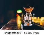 cocktail drink on night club.... | Shutterstock . vector #631034909