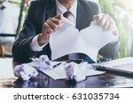 businessman tearing contract | Shutterstock . vector #631035734
