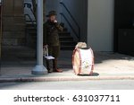Small photo of BRISBANE, AUSTRALIA - APRIL 25, 2017: Man dressed in a World War 2 uniform rests after performing in the ANZAC parade.