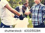little boys picking up plastic...   Shutterstock . vector #631050284