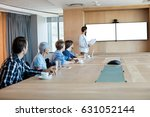 man giving presentation to her... | Shutterstock . vector #631052144