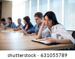 bored woman sitting in meeting... | Shutterstock . vector #631055789