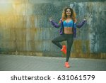 young girl in sportswear doing... | Shutterstock . vector #631061579