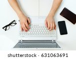 workspace with hands typing on... | Shutterstock . vector #631063691