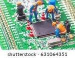 miniature computer engineers... | Shutterstock . vector #631064351