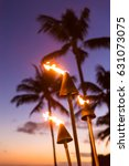 hawaii sunset with lit tiki... | Shutterstock . vector #631073075