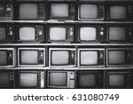 Pattern wall of pile black and white retro television (TV) - vintage filter effect style.