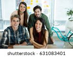 smiling creative business team... | Shutterstock . vector #631083401