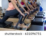 group of women exercising on... | Shutterstock . vector #631096751