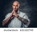 praying shaved head male with... | Shutterstock . vector #631102745