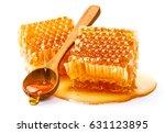 Honeycomb With Honey Spoon...