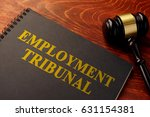 Small photo of Book with title employment tribunal on a table.