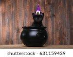 Stock photo cute black halloween witch cat 631159439