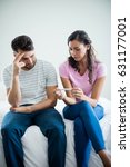 worried couple finding out... | Shutterstock . vector #631177001