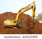 Small photo of Next to Lake Izabal, Guatemala - 30 March, 2017: Excavator KOMATSU is digging and mixing laterite nickel ore on the ore stockpile yard. Heavy machinery equipment.