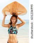 beautiful fit surfing girl in... | Shutterstock . vector #631236995
