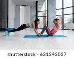 two young muscular sportswomen... | Shutterstock . vector #631243037
