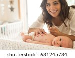 young mother moisturizing baby... | Shutterstock . vector #631245734