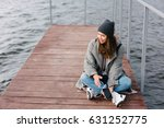 young pretty girl on wooden... | Shutterstock . vector #631252775