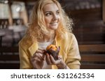 beautiful blonde holds in his...   Shutterstock . vector #631262534